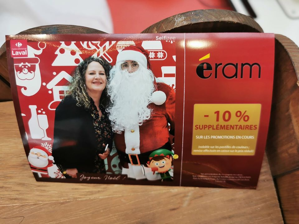 Animation coupon de réduction détachable imprimé via borne photo Selfizee pour offre Noël 2019 centre commercial Carrefour Laval